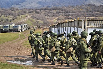 "Annexation of Crimea by the Russian Federation - ""Little green men"" and lorries after the seizure of Perevalne military base, 9 March 2014"