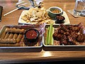 2018-02-14 15 18 08 Appetizers (Chips with spinach-artichoke dip, mozzarella sticks, and honey-bbq buffalo wings) at the Applebee's in Fair Lakes, Fairfax County, Virginia.jpg