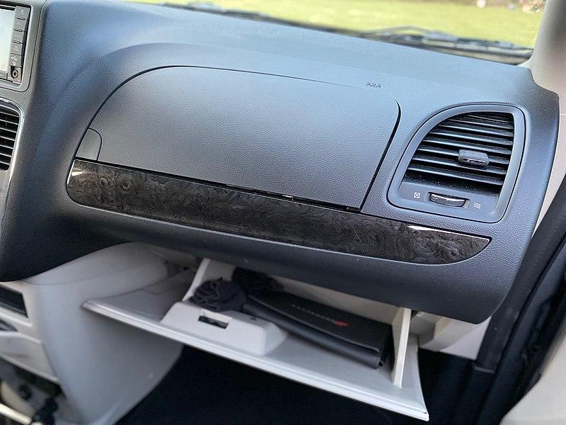File:2018 Dodge Grand Caravan SE in silver - view of the lower glove box open.jpg