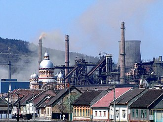 Reșița works - Dormition of the Theotokos Church flanked by blast furnaces