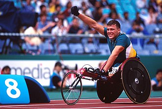 Kurt Fearnley - Fearnley waves to the crowd at the 2000 Sydney Paralympics
