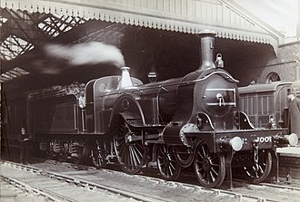 "Great Northern Railway (Great Britain) - Great Northern Railway Stirling ""Single"" 4-2-2 express locomotive at Peterborough North railway station. At their introduction in 1870, these were the fastest steam locomotives in the world."