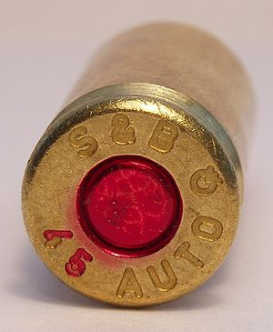 Centerfire ammunition - The primer of this unfired cartridge has been sealed with red lacquer to prevent oil or moisture from reaching the powder charge and priming explosive.