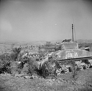 7th Armoured Brigade (United Kingdom) - Two Sherman tanks of the 6th Royal Tank Regiment in action against German machine gun positions on the walls of San Marino, during the Battle of San Marino, September 1944.