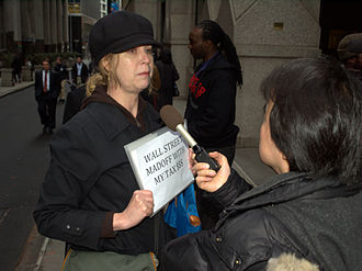 Financial crisis of 2007–2008 - A protester on Wall Street in the wake of the AIG bonus payments controversy is interviewed by news media.