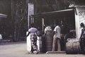 ASC Leiden - F. van der Kraaij Collection - 02 - 032 - A woman with basket. A makeshift gasstation up country - Montserrado County, Liberia, 1975.tiff