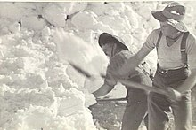 Men clearing snow with shovels