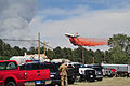 A DC-10 aircraft releases a fire-retardant solution to help stop the spreading of fires in El Paso 130612-Z-WF656-031.jpg