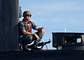 A Sailor provides security for USS Scranton. (11225136293).jpg