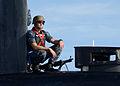 A Sailor provides security for USS Scranton. (11225136293).jpg
