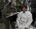 A U.S. Airman, left, with the 133rd Medical Group, Minnesota Air National Guard takes the medical history from a role player in a chemical enhanced response force package training exercise in Little Falls 130522-Z-LY731-346.jpg