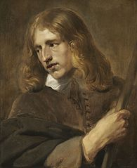 A Young Man Holding a Staff