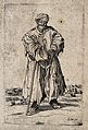 A bearded beggar dressed in rags holding a hat and a staff i Wellcome V0020324EL.jpg