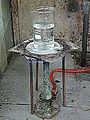 A laboratory heat spreader made of asbestos, over Teclu burner.jpg
