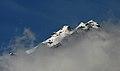 A peak among clouds on way to Zirmi Thaatch Im IMG 6948.jpg