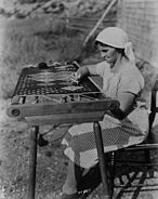 Acadian lady making rug 1938