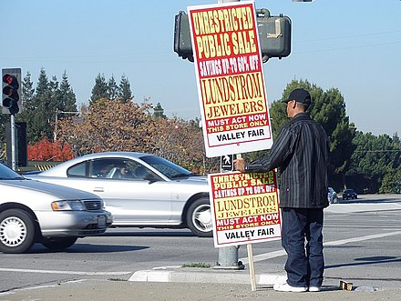 Paying people to hold signs is one of the oldest forms of advertising, as with this human billboard. Advertisingman.jpg