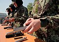 Afghan National Army trainees disassemble and reassemble sidearms at Kabul Military Training Center.jpg