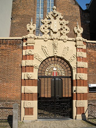 """Athenaeum Illustre of Amsterdam - The Baroque gate of the Agnietenkapel, which was originally made in 1571, was moved here in 1631, and today has an iron gate attached that spells out """"Athenaeum Illustre 1632-1921"""""""