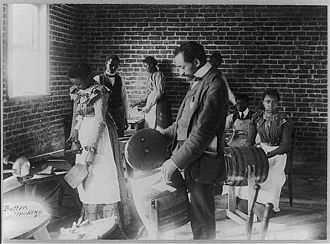 North Carolina Agricultural and Technical State University - An early image of students learning to make butter.