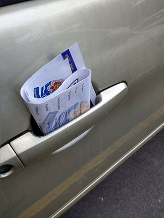 Loan shark - Ah Long pamphlet found in a car door handle in Malaysia