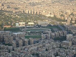 العربية: استاد الفيحاءالرياضي في دمشق، سورية م...