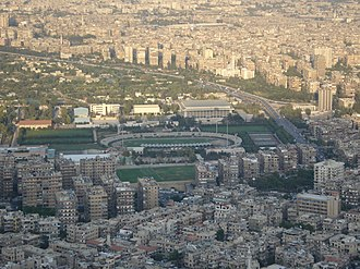 Al-Fayhaa Sports Complex Al-Fayhaa Stadium in Damascus, Syria as seen from Mount Qasioun.jpg