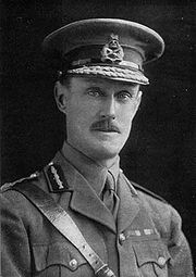 head and shoulders portrait of man in military uniform and hat