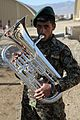 An Afghan National Army soldier with the 203rd Corps band plays a new euphonium donated by the U.S. Army's 101st Airborne Division Band Dec. 14, 2013, at Forward Operating Base Thunder in Paktia province 131214-A-YW808-097.jpg