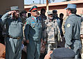 An Afghan police graduate of officer candidate school salutes Afghan National Police Maj. Gen. Salim Ehsas, the commander of the 404th Maiwand District, during a graduation ceremony at the Kandahar training 120129-F-FR276-062.jpg