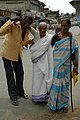 An old woman is being coming out after casting her vote in the first phase of Assam assembly election in Silchar, on April 3, 2006.jpg