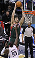 Andrew Bogut dunk over Hamady N'diaye.jpg
