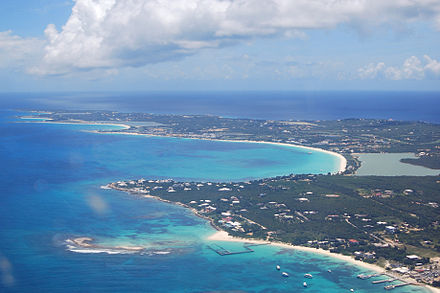 An aerial view of the western portion of the island of Anguilla. The Blowing Point ferry terminal is visible in the lower right, as are (right to left) Shaddick Point, Rendezvous Bay, Cove Bay and Maundays Bay. Anguilla-aerial view western portion.jpg