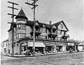 Apartments and businesses, 12th Ave E and E Pike St, ca 1912 (SEATTLE 2441).jpg