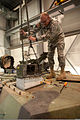 Army 1st Sgt. Mike Dunn, a mechanic with the Camp Atterbury Joint Maneuver Training Center's Unit Training Site, uses a shop lift to remove the primary gunner's sight on an M1 Abrams tank, near Edinburgh, Ind. 111101-A-PX072-120.jpg
