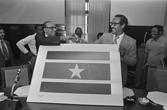 Jagernath Lachmon - Jagernath Lachmon and Prime Minister Henck Arron with the new flag in November 1975