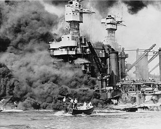 United States Office of War Information - Pearl Harbor, Hawaii. A small boat rescues a seaman from the 31,800 ton USS West Virginia burning in the foreground.