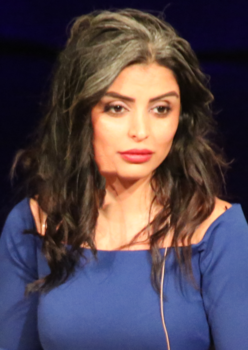 Author Sara Omar on stage (cropped).png