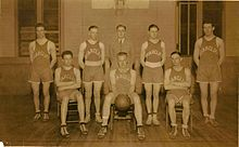 Basketball players in a group photograph