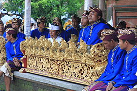 Balinese men playing gamelan.jpg