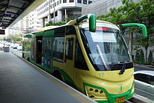 Modern green-and-yellow bus