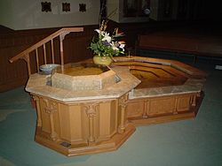 "The baptistry at St. Raphael's Cathedral, Dubuque, Iowa. This particular font was expanded in 2005 to include a small pool to provide for immersion baptism of adults. Eight sided font architectures are common symbology of the day of Christ's Resurrection: the ""Eighth Day."""