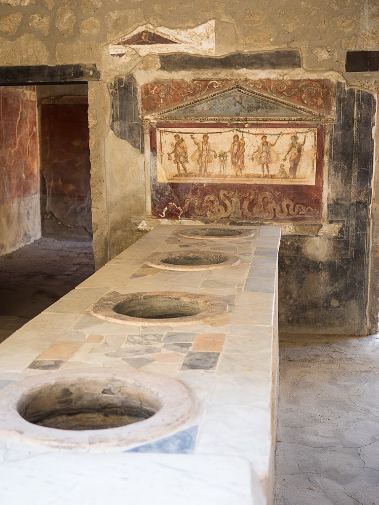 File Bathroom With Toilets And Wall Art In Pompeii 2016