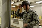 Behind the gas mask, IPE personnel 160510-F-IW330-049.jpg