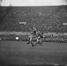 Eusébio strikes against Real Madrid during the 1962 European Cup Final. d61589ea5cc36
