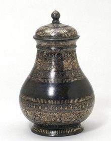 A decorated metal vase on display