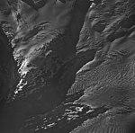 Blackstone Glacier, terminus of tidewater glacier, with bergschrund on the surrounding mountain glaciers, August 25, 1964 (GLACIERS 6401).jpg