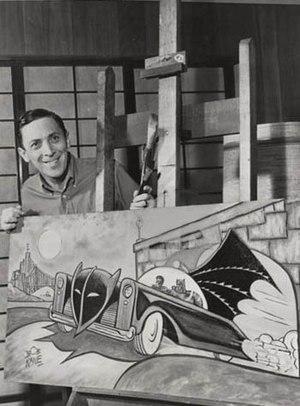 Bob Kane - Kane posing with a Batmobile painting, 1966