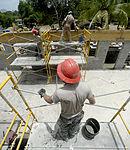 Bond beam work at Gabriela Mistral School construction site 150622-F-LP903-701.jpg