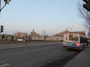 De L'Assomption Boulevard - An STM bus waits outside the Assomption metro station